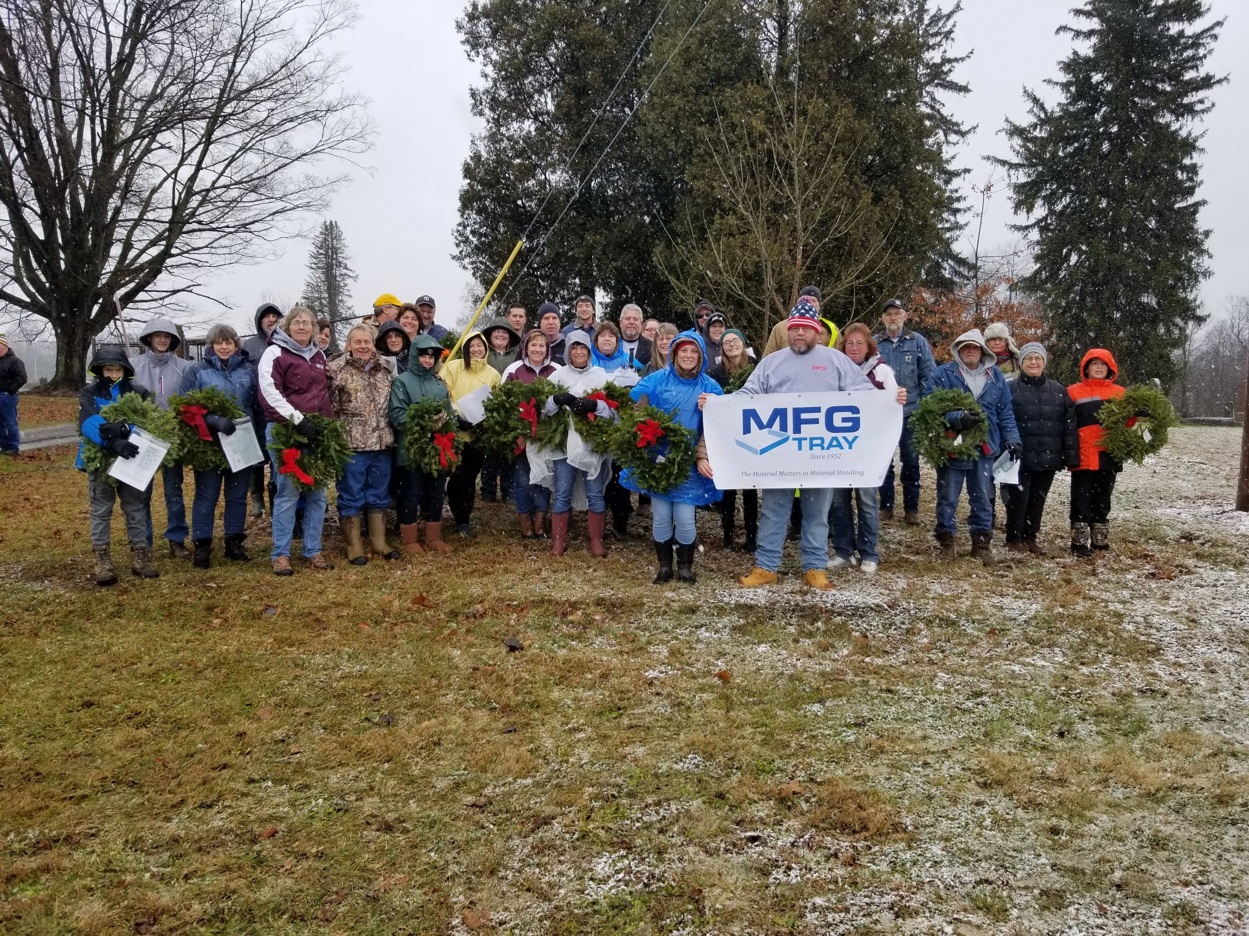 50 MFG Tray teammates and family gathered to volunteer for Wreaths Across America at Linesville Cemetery in Linesville, Pennsylvania
